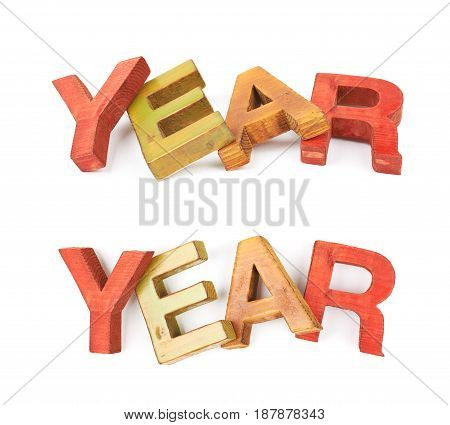 Word Year made of colored with paint wooden letters, composition isolated over the white background, set of two different foreshortenings