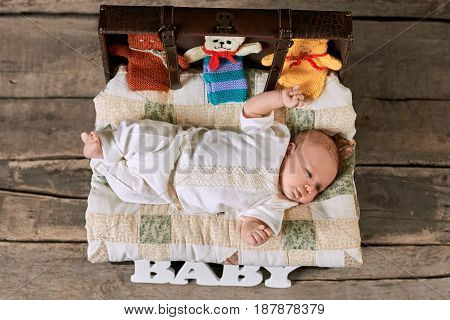 Small child lying on blanket. Top view of baby. Adorable facts about babies.