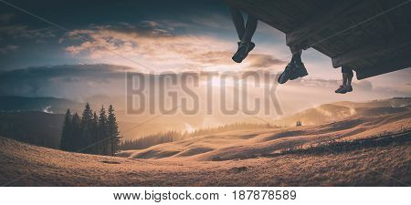 Hikers Sit Above The Mountain Valley. Instagram Stylization
