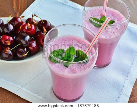 Healthy pink smoothie liquid food with cherries Greek yogurt in glasses