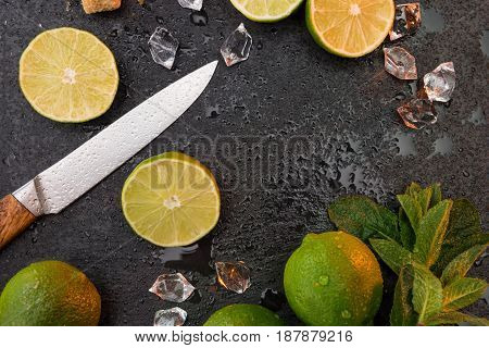 Lemon Lime Slices With Mint Leaves And Knife On Stone Board, Barman Cocktail