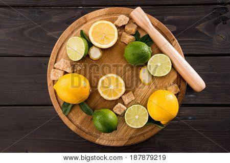 Top View Of Lemons And Limes With Brown Sugar On Wooden Kitchen Board, Barman Cocktail