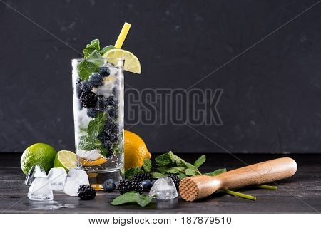 Blueberry And Blackberry Lemonade In Glass With Straw, Cocktail Bar Background Concept