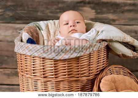 Baby in a willow basket. Look of a little kid.