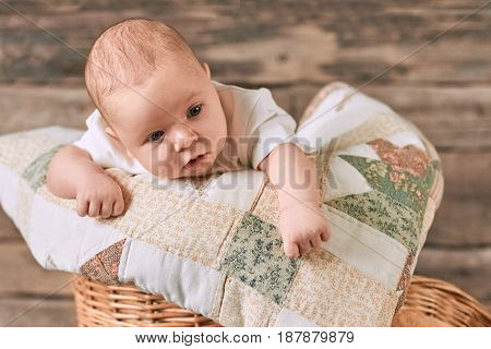 Cute caucasian baby. Child with eyes wide open.