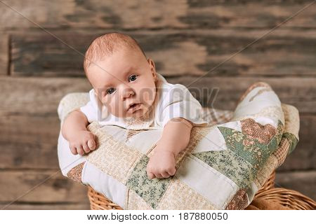 Adorable caucasian infant. Little child and blanket.