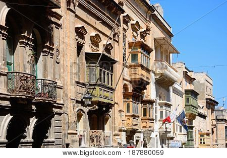 VALLETTA, MALTA - MARCH 30, 2017 - Elaborate buildings along Republic Street aka Triq Ir Repubblika Valletta Malta Europe, March 30, 2017.