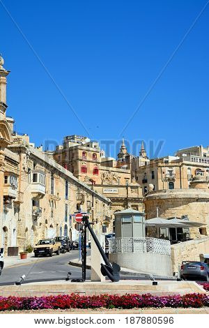 VALLETTA, MALTA - MARCH 30, 2017 - Traffic island with Victoria Gate Ta Liesse Church and town buildings to the rear Valletta Malta Europe, March 30, 2017.