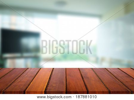 Selected focus empty brown wooden table and meeting room or office work blur background image. for your photomontage or product display