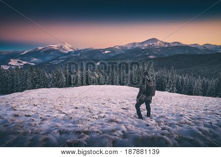 Hiker Standing On A Hill With Snow. Instagram Stylization