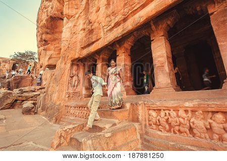 BADAMI, INDIA - FEB 10, 2017: People looking ancient caves with the 6th century Hindu temple and carved columns on February 10, 2017. Population of Karnataka state is 62000000 people