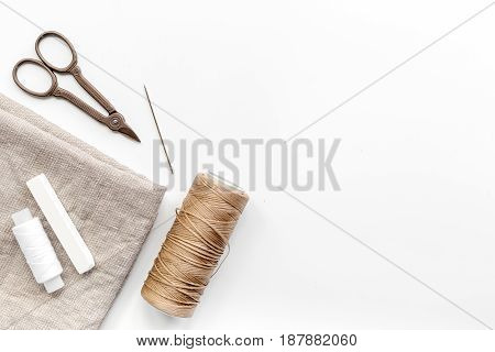 Sewing tools, fabric and kit for handmade hobby collection on white background top view mock-up