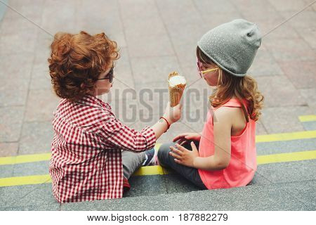 photo of two cute hipsters eating icecream