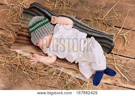 Baby lying on a scarf. Top view of little kid.