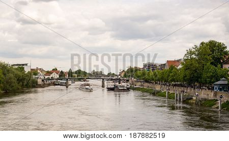 Regensburg,Germany-May 20,2017: A sightseeing boat on the Danube arrives to pick up tourists for a tour