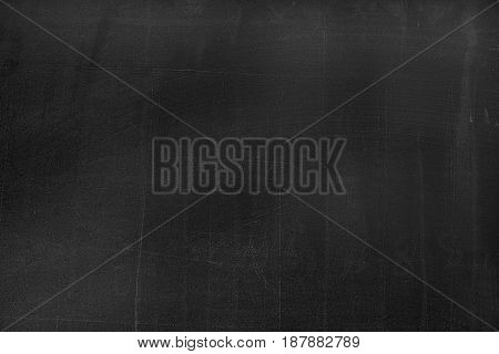 Black Board With The Traces Of Chalk Over Its Surface As A Background