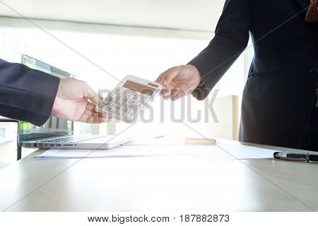 businessman send calculator to manager for estimation working invesment concept.