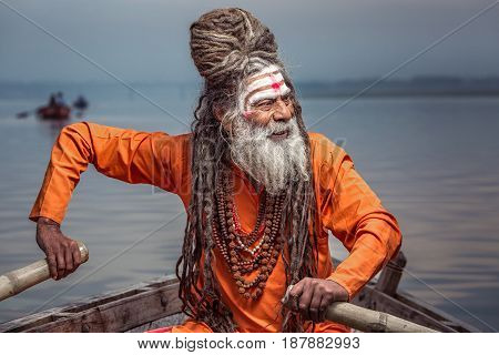 Portrait of sadhu rowing in the boat, Varanasi, India.