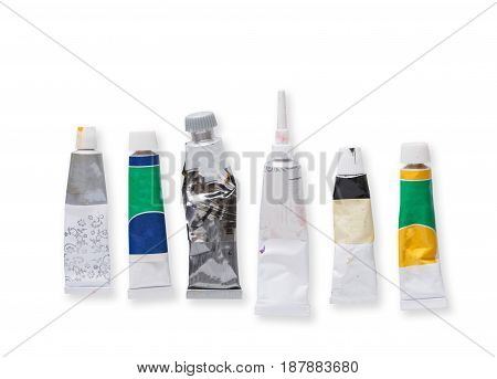 Drawing tools, set of tubes with oil-paint and acrylic isolated on white, top view, copy space
