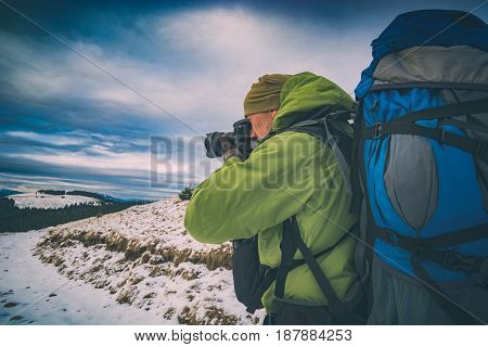 Hiker With A Camera And Big Backpack. Instagram Stylization