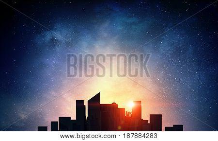 Sunset above modern city