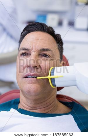 Male patient receiving dental treatment in clinic