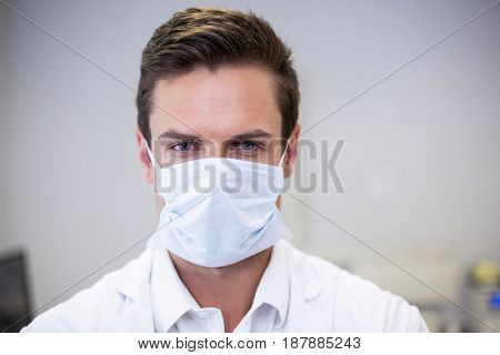 Portrait of dentist wearing surgical mask in clinic