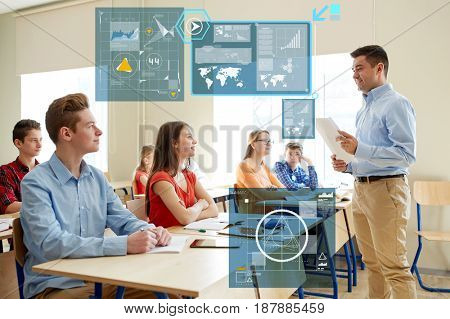 education, statistics and people concept - group of happy students and teacher with papers or tests at school over virtual screens with charts