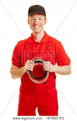 Electrician standing and smiling with a red overall