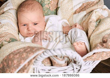 Infant boy and blanket. Cute little caucasian kid.