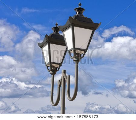 the street lantern on background blue sky