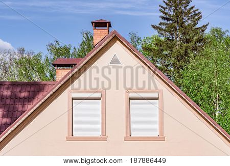 Roof of the house in the spring forest.