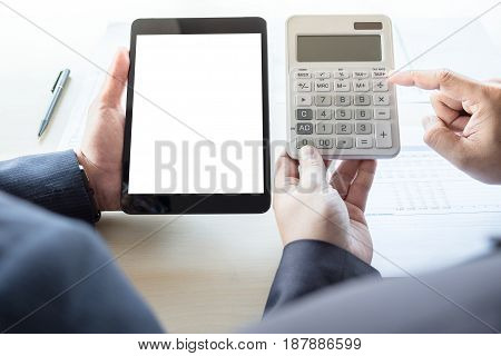 Businessman analysis on calculator new plan financial graph data with business colleagues using digital tablet for estimation at the office invesment concept.
