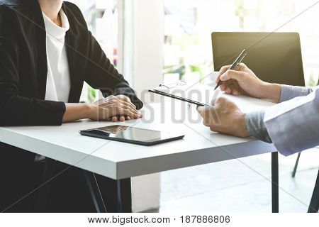 Healthcare and Medical concept Doctor and patient are discussing something just hands at the table.