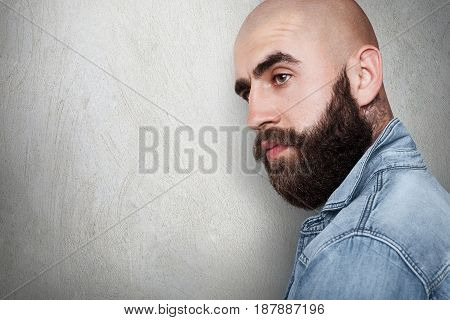 A Sideways Portraitwith Copy Space Of Fashionable Bald Hipster Having Tattoo On His Neck, Thick Blac