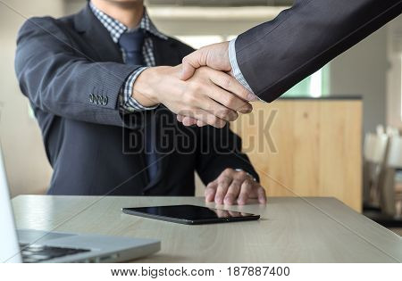 Business partnership meeting concept. Images of business people shaking hands while greeting at the working place. businessmen handshaking after good deal success.