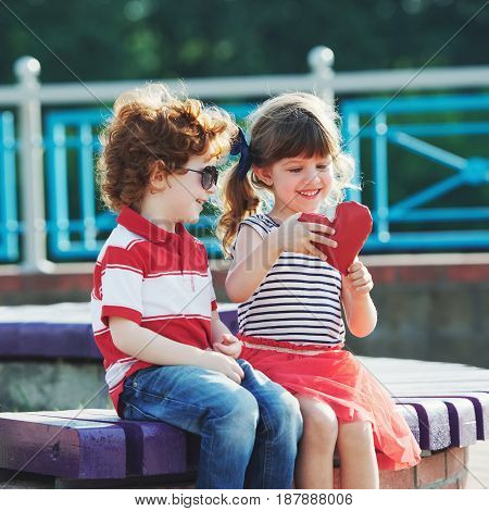 photo of little boy and girl with heart