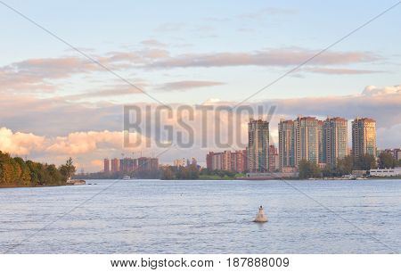 View of Neva river and microdistrict Ribatskoe on the outskirts of St. Petersburg at sunset Russia. poster
