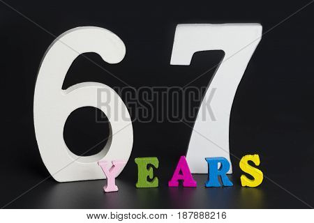 Letters And Numbers-sixty-seven On A Black Background.