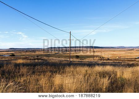 Autumn Colored Dry Grass Against Rural Country Landscape