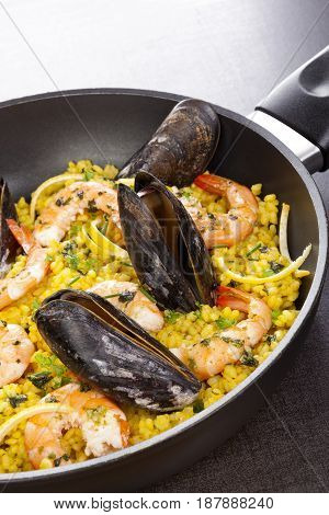 Delicious paella in pan with shells. Mediterranean seafood paella