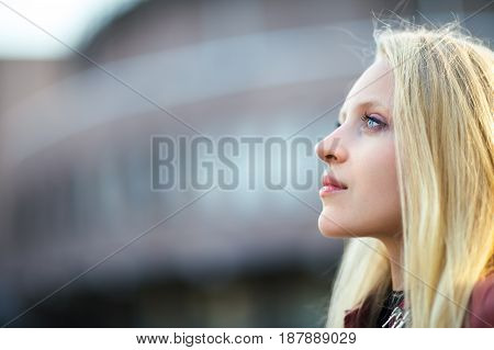 Profile Portrait Of Young Beautiful Blond Woman In City Street On Sunset