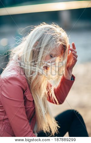 Beautiful Blonde Woman With Wind In Hair. Emotional Art Portrait