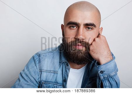 A Horizontal Close-up Of Handsome Bald Man Having Charming Dark Eyes, Thick Black Eyebrows And Beard