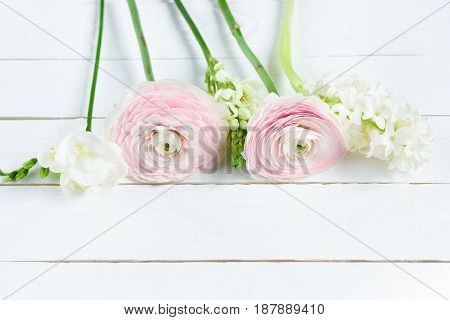 Close-up View Of Beautiful Tender Pink And White Flowers On Wooden Table