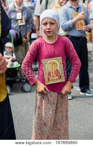 KIEV UKRAINE - JULY 27 2016 : Children and parishioners Ukrainian Orthodox Church Moscow Patriarchate in religious procession. At present there is war of Kiev Patriarchate and Moscow Patriarchate