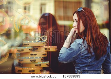 Beautiful Woman At The Window Of The Shop