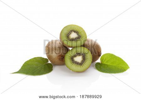 Sliced and whole kiwi with leaves isolated on white background