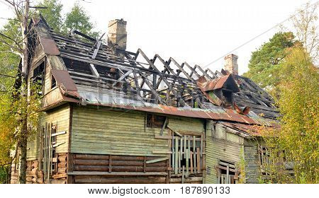 Burned down rustic wooden house after the fire.