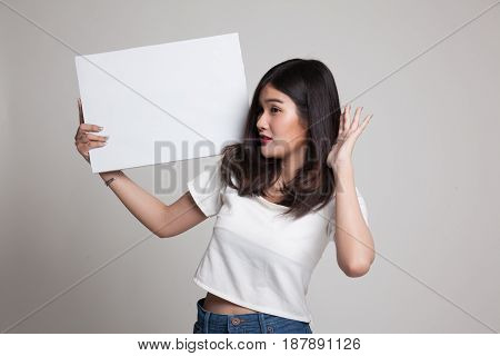 Young Asian Woman  Surprise With  White Blank Sign.